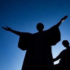 silhouette of statue of alma mater